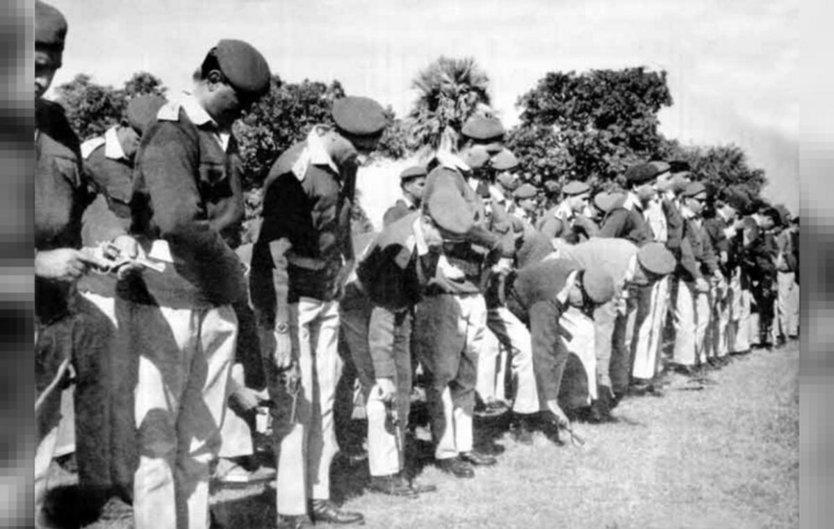 Pakistani soldiers removing their unit Insignia after surrender