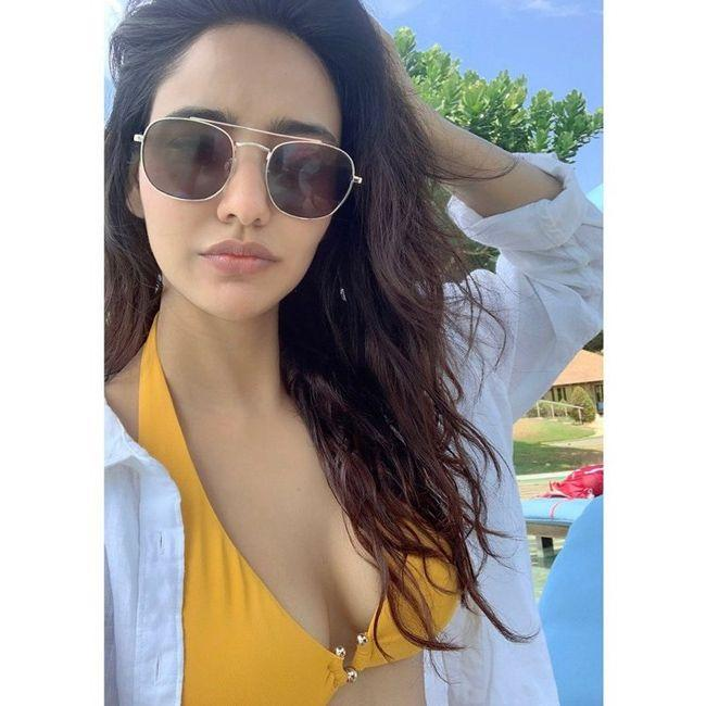 Neha Sharma Stunning Poses