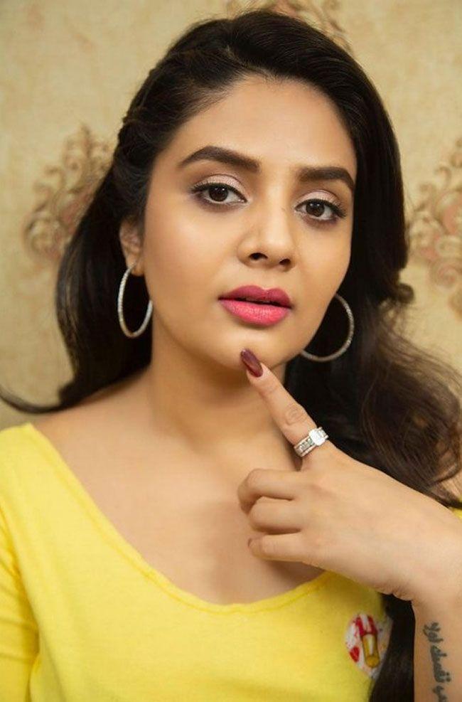 See How Sreemukhi Looks Beautiful In Yellow Dress