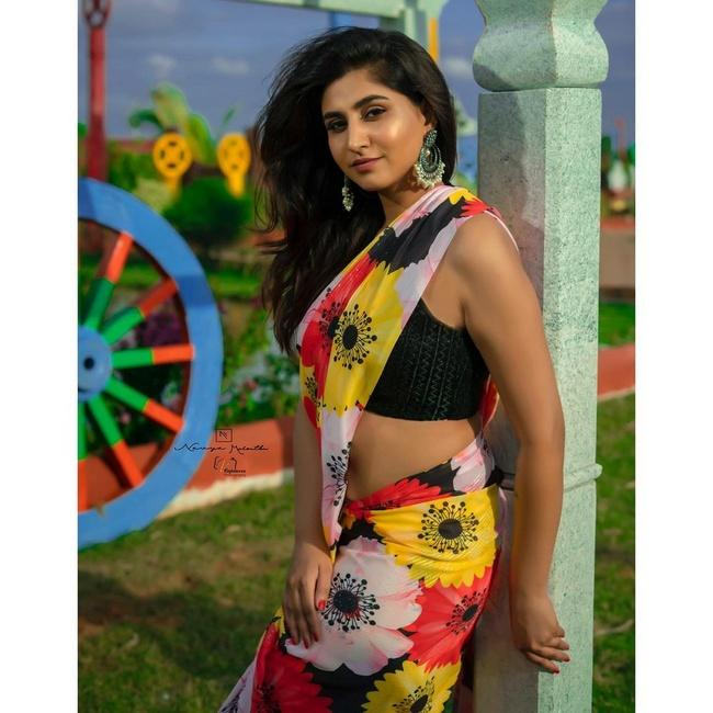 Varshini Is Glamorous Looks in a Floral Saree