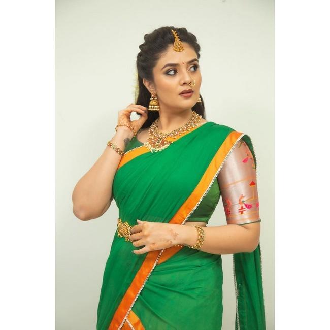 Sreemukhi Looking Pretty in a Green Half Saree