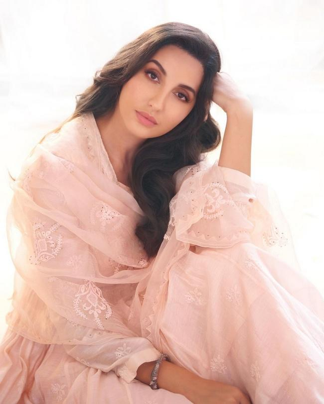 Actress Nora Fatehi Stunning Looks in White Dress