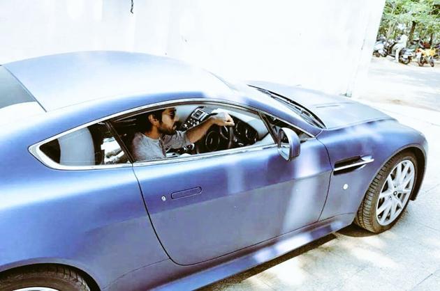 Ram Charan in his swanky Aston Martin car Photos