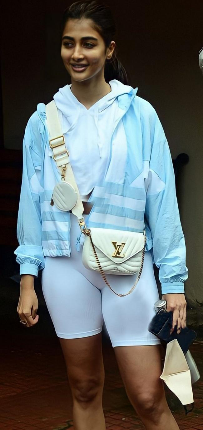 Actress Pooja Hegde Spotted in White short and Sky blue Jacket