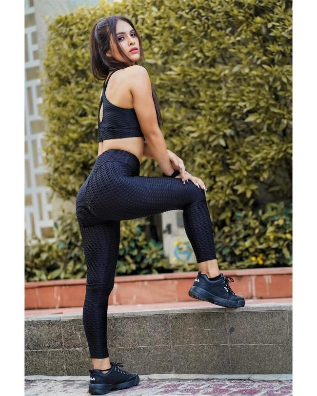 Neha Malik is Sultry Poses In Gym Dress
