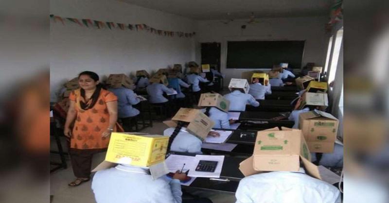 कर्नाटक में नकल रोकने के लिए छात्रों को पहना दिए गत्ते के डिब्बे