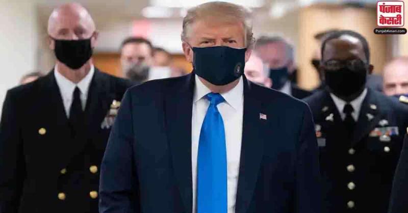 US में कोरोना का कहर बरकरार, सैन्य अस्पताल के दौरे के दौरान पहली बार मास्क पहने नजर आए ट्रंप