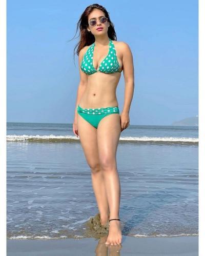 Pic Alert: Neha Malik Makes It Irresistible With Her Bikini Looks!     Tupaki English