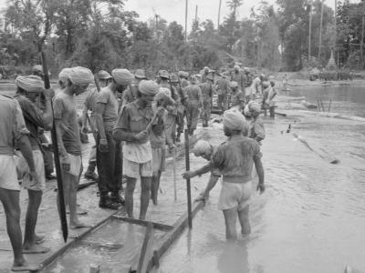 Indian engineers construct a wooden bridge over a shallow stream or 'chaung' during the advance to Rangoon. Photo: Wikimedia Commons/No 9 Army Film & Photographic Unit, Stubbs A (Sgt), Public domain