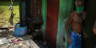 Saifullah outside his charred house, Telinipara. Photo: Himadri Ghosh