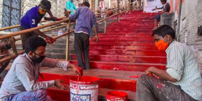 Workers paint the staircase that falls in the way to the Ram Janmabhoomi  site as part of preparations ahead of the ground-breaking ceremony for the construction of the Ram Temple, in Ayodhya, Friday, July 31, 2020. Photo: PTI