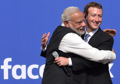 California: Prime Minister Narendra Modi hugs CEO of Facebook, Mark Zuckerberg at Facebook headquarters in California on Sunday.    PTI Photo by Subhav Shukla    (PTI9_27_2015_000340B)