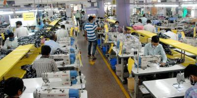 Workers at an apparel manufacturing company in Noida during the COVID-19-induced lockdown. Photo: PTI