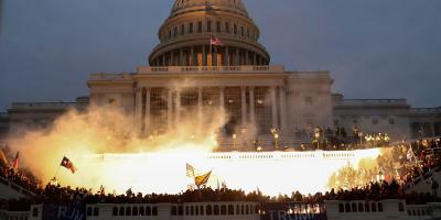 An explosion caused by a police munition is seen while supporters of US President Donald Trump gather in front of the US Capitol Building in Washington, US, January 6, 2021. Photo: REUTERS/Leah Millis