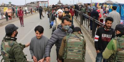 Men stand in line for checking and frisking by security forces in Srinagar on Monday, February 22. Photo: Kaisar Andrabi
