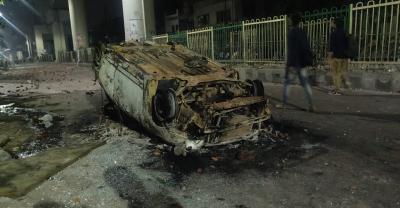 A car burnt in Maujpur during the Delhi riots. Photo: Naomi Barton