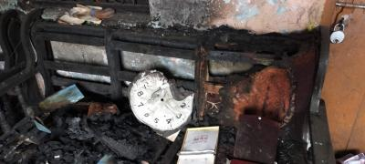 A burnt clock inside a riot-affected house in North East Delhi's Chand Bagh. Photo: Ismat Ara