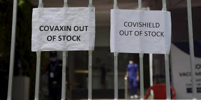Posters at a COVID-10 vaccination centre declare it has no available stock in Mumbai, April 30, 2021. Photo: PTI/Kunal Patil
