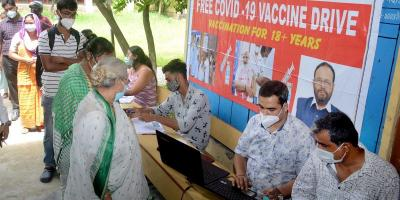 People stand in a queue to receive a COVID-19 vaccine dose at a centre, in Guwahati, July 23, 2021. Photo: PTI