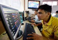 Sensex soars to record high on earnings cheer; Nifty reclaims 11k-mark