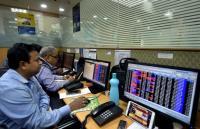 Markets continue record run on earnings boost; bank, power stocks climb