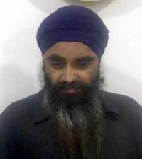 2 held affixing Sikh Referendum posters