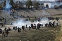 US fires teargas into Mexico to repel migrants, closes border gate