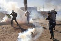 US fires tear gas to repel migrants