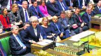Brexit in turmoil as May defers vote