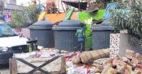 Locals raise stink over garbage woes