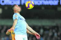 City ease past 10-man Wolves to cut gap at top