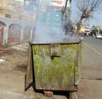 Bonfire remnants damage garbage bins in city