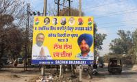 Hoardings without Dev's pictures flare up controversy