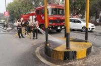 Using fire brigade vehicle to clean roads raises eyebrows