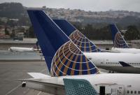 Winter storm forces airline cancellations, road troubles
