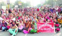 Contractual workers take out march, block traffic