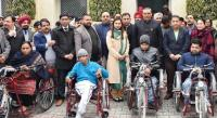Minister distributes artificial limbs, accessories among divyangs
