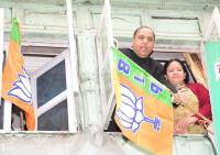 CM hoists BJP flags on party worker's house