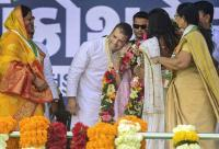 Woman Cong worker kisses Rahul Gandhi on stage in Gujarat