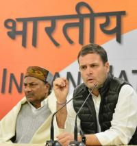 Stand with government, won't be divided, say Rahul Gandhi, Manmohan Singh