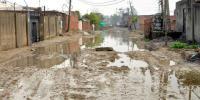 Rain turns roads slushy, traders fume