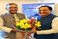 सीएम ने नई दिल्ली में निशंक से की शिष्टाचार भेंट, नया कार्यभार संभालने पर दी बधाई